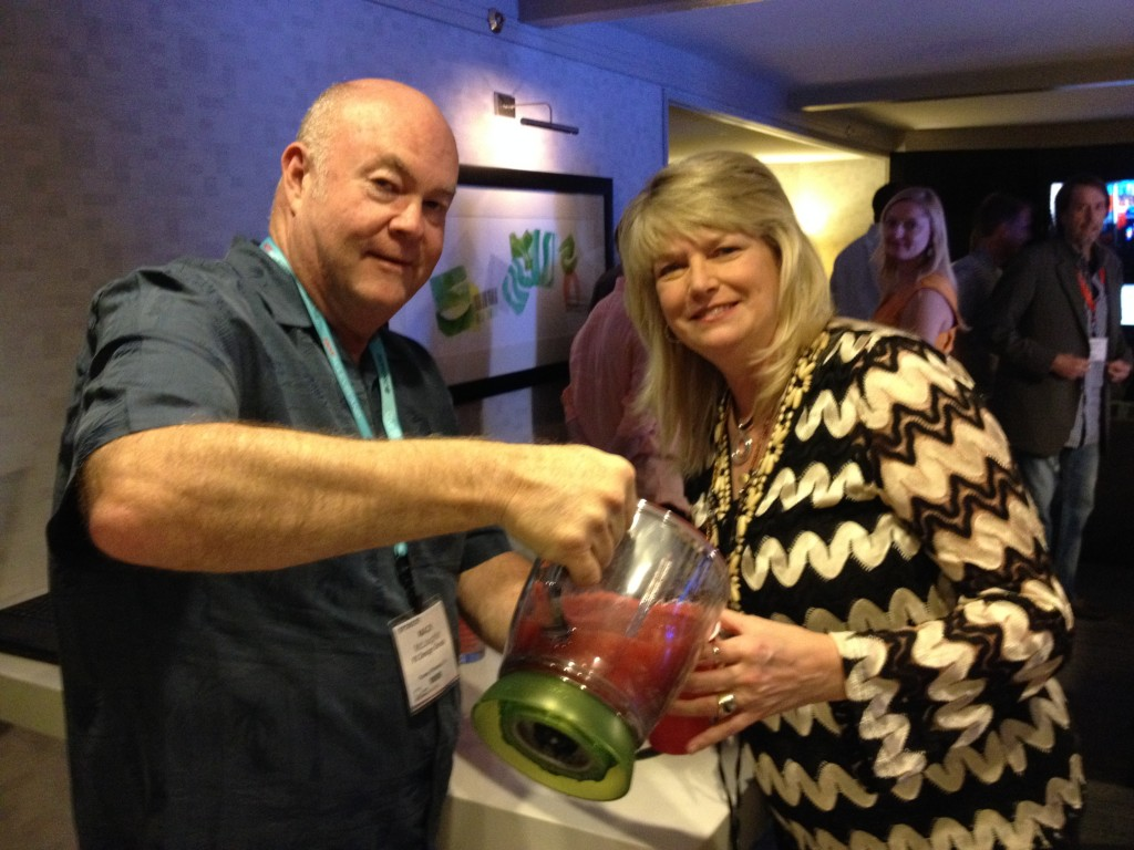 Mark McLaughlin, CEO, FX Design Group and Bonnie Barclay, VP of Marketing mixing it up at their party.